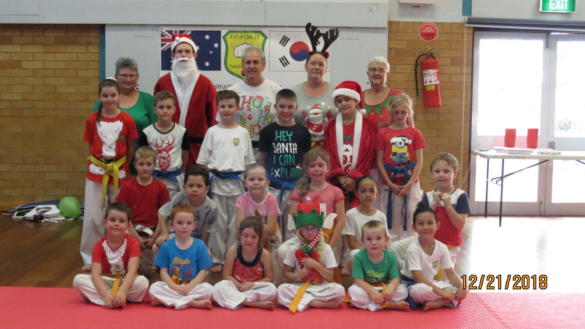 The Tamworth Martial Arts Team all dressed up in Christmas gear for their end of year photo.