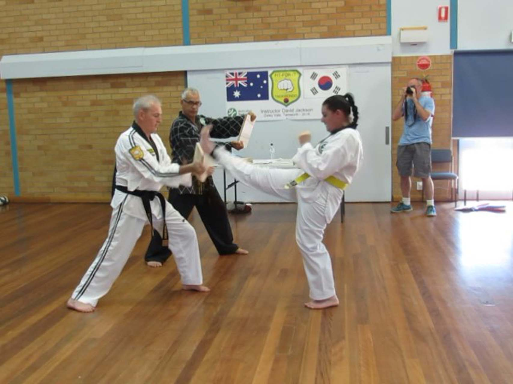A young female practices kicking during a taekwondo class in Tamworth.