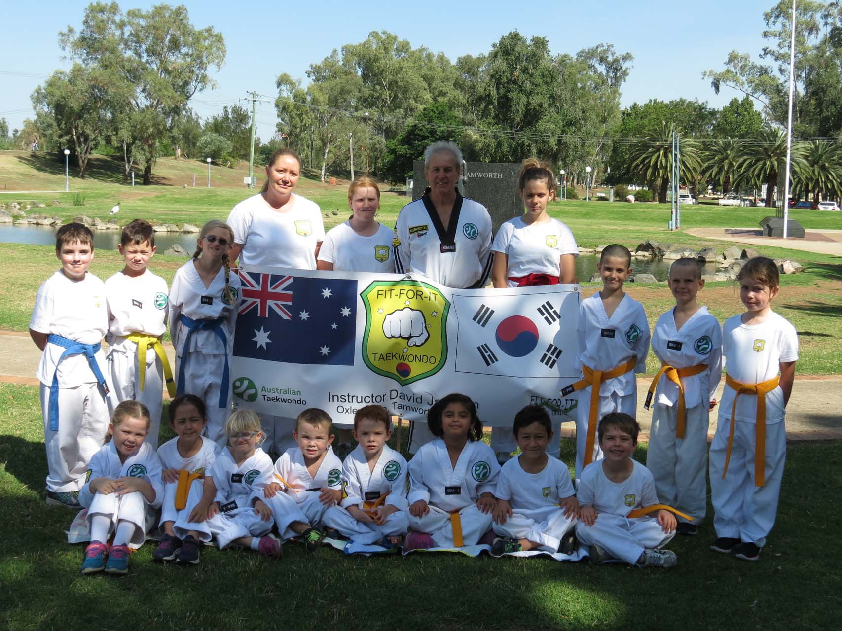 Martial arts students getting their photo taken with their instructor outside in Tamworth.