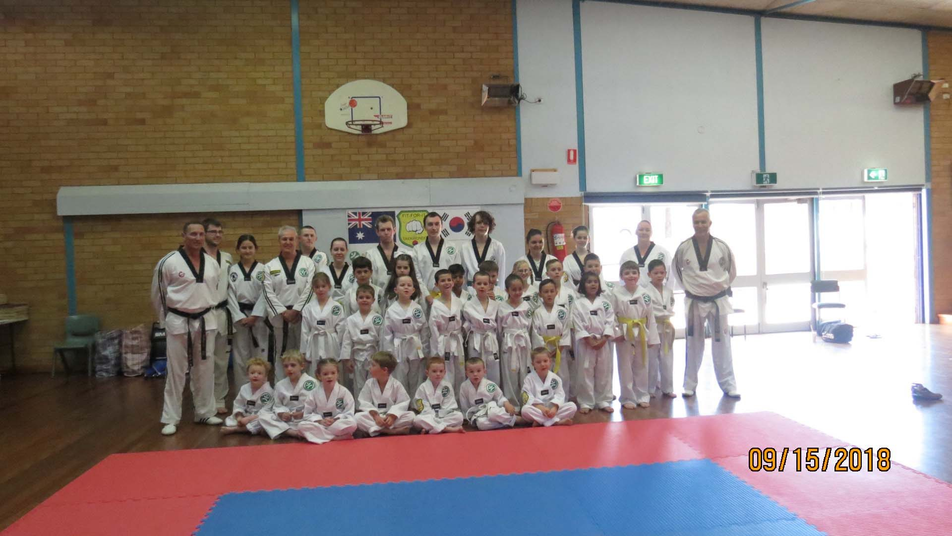 A large class of taekwondo students at Tamworth Martial Arts, ready to begin their session.