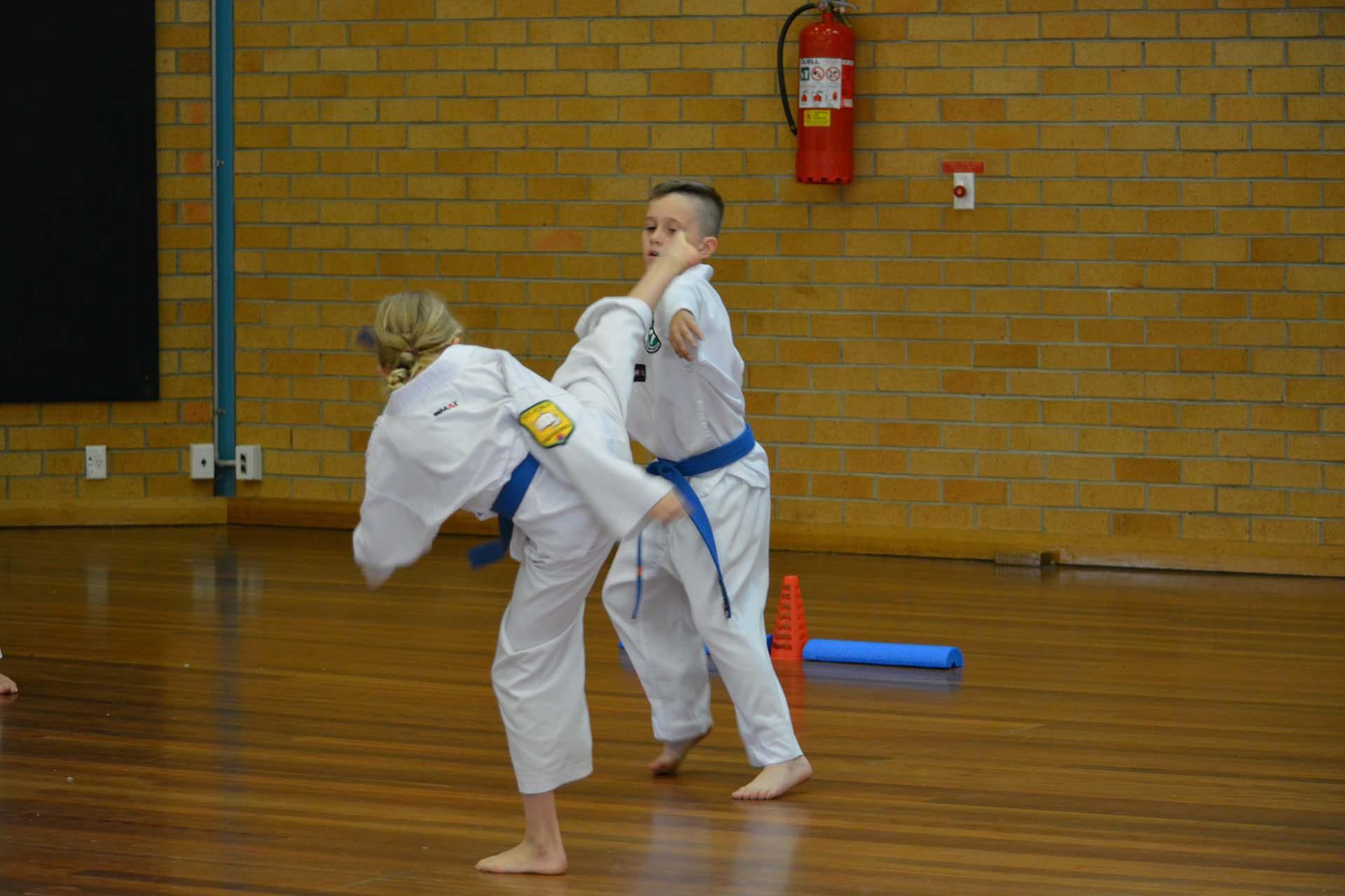 Two junior martial arts students practicing taekwondo at Tamworth martial arts.