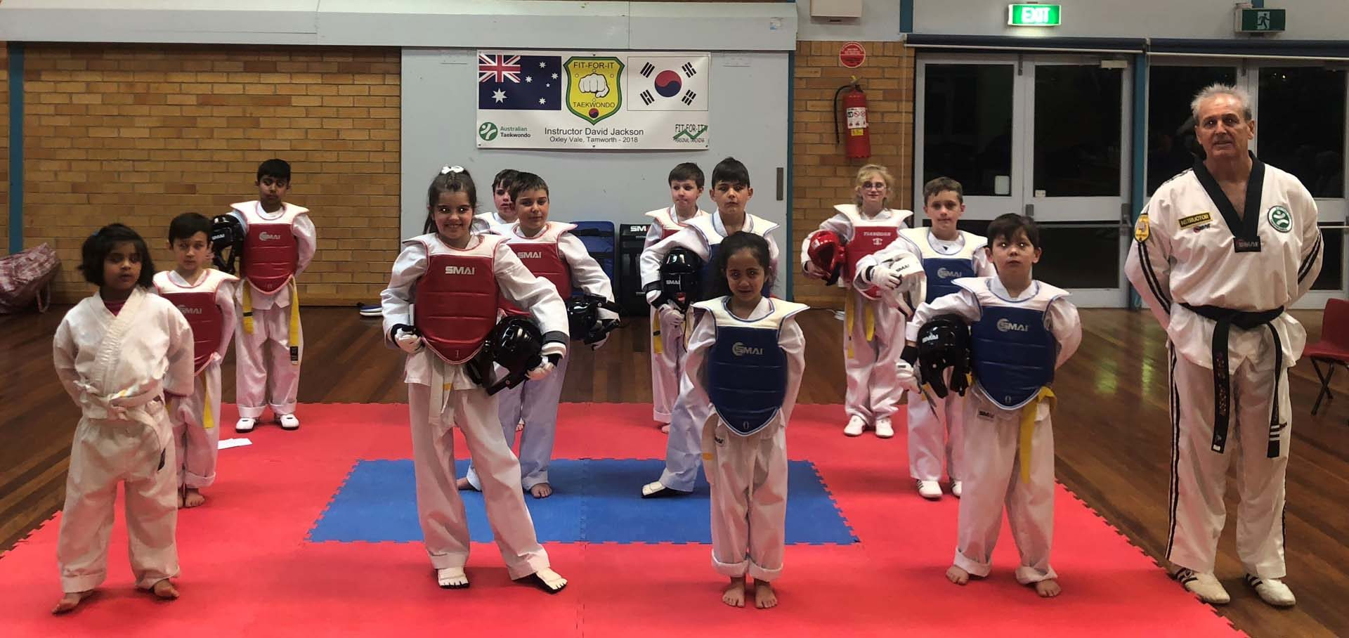 A taekwondo tournament in Tamworth with a group of students facing camera ready to practice martial arts.