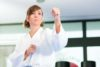 A young woman practices her Taekwondo stance at Tamworth Martial Arts.